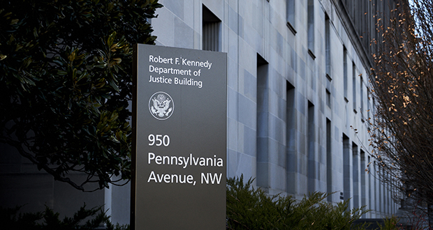 Signage stands outside the U.S. Department of Justice headquarters in Washington, D.C. (Bloomberg News photo)