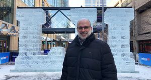 trademarks-christopher-j-schulte-esq-partner-and-chair-of-the-trademark-practice-group-merchant-gould-standing-in-front-of-super-bowl-ice-sculpture