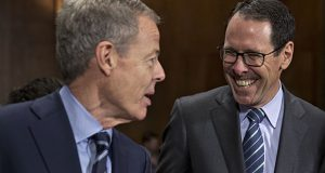 Randall Stephenson, chairman and chief executive officer of AT&T Inc., right, speaks with Jeffrey Bewkes, chairman and chief executive officer of Time Warner Inc., before a Senate Judiciary Subcommittee hearing Dec. 16, 2016, in Washington, D.C. (Bloomberg file photo)