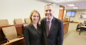 Assistant U.S. Attorney Julie Allyn, and her father, Robins Kaplan partner Richard Allyn, stand in the mock courtroom at Robins Kaplan's office in downtown Minneapolis. (Staff photo: Bill Klotz)