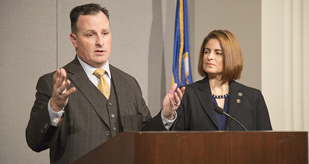 Rep. John Lesch, DFL-St. Paul, and Rep. Marion O'Neill, R-Maple Lake, are shown at a Dec. 11 press conference where they first announced their plan to use the Ethics Committee as a mechanism for expedited investigation and disposition of sex-harassment complaints at the Capitol. (Staff photo: Bill Klotz)