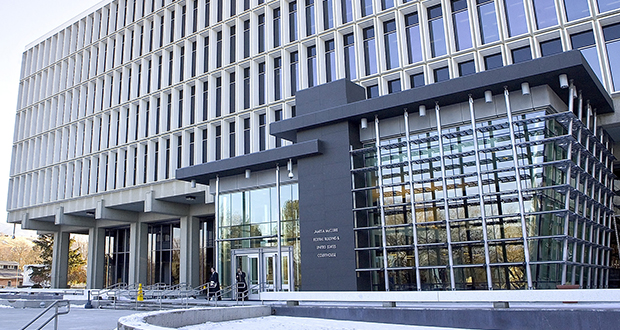 A federal judge says Idaho can't continue automatically rejecting applications from transgender people seeking to change the gender listed on their birth certificates. In this photo visitors leave the James A. McClure Federal Building and United States Courthouse in downtown Boise, Idaho. (AP file photo)