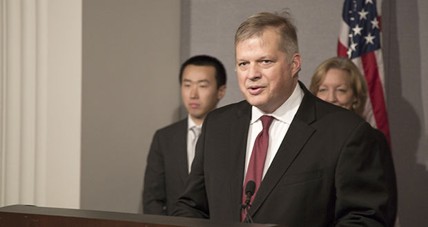 Attorney Erick Kaardal speaks to reporters on Nov. 13 to announce that the U.S. Supreme Court accepted a writ of certiorari on his case Minnesota Voters Alliance, et al., v. Mansky. Wen Fa, a Pacific Legal Foundation attorney who is assisting with the case, stands behind Kaardal at left. (Staff photo: Kevin Featherly)