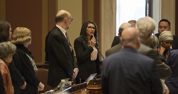 When Rep. Erin Made Quade, DFL-Apple Valley, rose on the House floor March 29 to speak in support of a motion to suspend House rules and debate a bill to create a Capitol sexual harassment task force, many of her DFL colleagues stood up beside her. The measure ultimately failed and the Legislature left shortly afterward for its Easter break.  (Staff photo: Kevin Featherly)