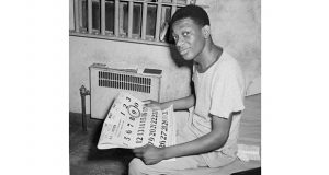 This undated photo shows Willie Francis holding a calendar with the date of May 9 circled. After a botched execution attempt on May 3, 1946, in Louisiana, the U.S. Supreme Court rejected his lawyer's appeal and ruled the state could try again. Francis was put to death on May 9, 1947. (AP file photo)