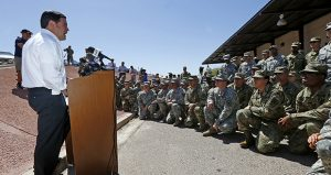 Arizona Gov. Doug Ducey speaks to Arizona National Guard soldiers Monday in Phoenix before their deployment to the Mexico border. (AP photo)