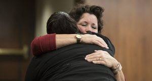 Rep. Mary Kunesh-Podein, DFL-New Brighton (facing camera), embraces St. Paul resident Mysti Babineau after Babineau gave wrenchingly personal testimony before the House Public Safety and Security Policy and Finance Committee on April 11. Kunesh-Podein has authored a bill to launch a task force to study the issue of missing and murdered indigenous women in Minnesota. (Staff photo: Kevin Featherly)