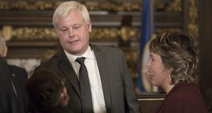 Newly appointed Minnesota Supreme Court Justice Paul Thissen greets his new colleague Justice Natalie Hudson on Tuesday while Justice Anne McKeig, right, looks on. Thissen, a DFL House member and former speaker, will resign from the Legislature on Friday. On Tuesday, Gov. Mark Dayton named him to replace Justice David Stras on the state's highest court. (Staff photo: Kevin Featherly)