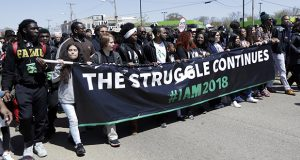 People march April 4 in Memphis, Tennessee, to commemorate the 50th anniversary of the assassination of Martin Luther King Jr. (AP photo)
