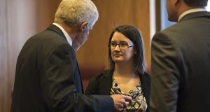 Destiny Dusosky, center, a DFL activist from Sauk Center, first sued Michelle Fischbach in January, hoping to persuade a judge to have her removed as senator. The suit was dismissed in February, but has since been refiled. (AP pool photo)