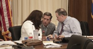 """House Speaker Kurt Daudt, R-Crown (center) huddles late Friday with committee co-chairs Sen. Julie Rosen, R-Vernon Center (left), and Rep. Jim Knoblach, R-St. Cloud, just before their supplemental budget conference committee began systematically eliminating provisions from the Legislature's 898-page """"Omnibus Prime"""" bill. (Staff photo: Kevin Featherly)"""