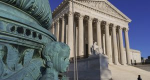 The Supreme Court is seen April 20 in Washington. The Supreme Court says employers can prohibit their workers from banding together to complain about pay and conditions in the workplace. (AP Photo: J. Scott Applewhite)