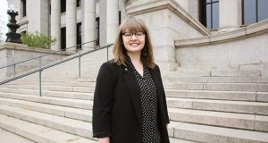 Alyssa Siems Roberson, director of public affairs for the Minnesota Judicial Branch, stands in front of the Minnesota Judicial Center in the Capitol complex in St. Paul. (Staff photo: Bill Klotz)