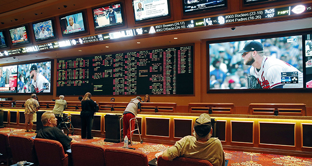 People make bets Monday in the sports book at the South Point hotel and casino in Las Vegas. Now the U.S. Supreme Court has cleared the way for states to legalize sports betting. (AP photo)
