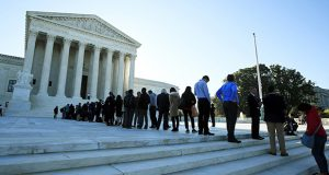 People line up outside the U.S. Supreme Court in Washington on Oct. 3, 2017, to hear arguments in a case about political maps in Wisconsin that could affect elections across the country. (AP file photo)