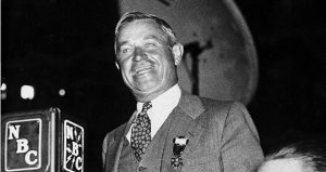 """Humorist Will Rogers takes to the speaker's stand at the 1932 Democratic National Convention in Chicago. After entertaining delegates, Rogers turned serious long enough to plead with his party to unite behind its nominee. Three years later, he famously quipped, """"I am not a member of any organized party — I am a Democrat. (AP file photo)"""