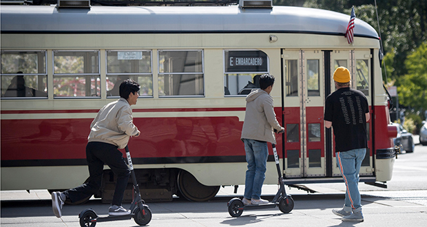 People ride Bird Rides Inc. shared electric scooters in San Francisco. (Bloomberg file photo)