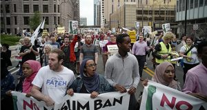 Demonstrators protest the Supreme Court's decision to uphold the Trump administration's travel ban Tuesday in downtown Minneapolis. (AP photo: Star Tribune)