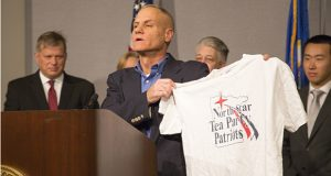 Minnesota Voters Alliance co-founder Andrew Cilek displays a Tea Party T-shirt. Election judges objected to the message, based on Minn. Stat. sec. 211B.11. (Staff photo: Kevin Featherly)