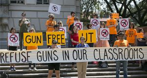 Protesters gather Oct. 1, 2015, on the West Mall of the University of Texas campus in Austin to oppose a state law that expands the rights of concealed handgun license holders to carry their weapons on public college campuses. (AP file photo: Austin American-Statesman)