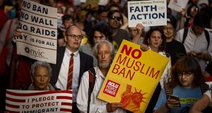 People protest the U.S. Supreme Court's decision to uphold President Donald Trump's ban on travel from several mostly Muslim countries on June 26 in New York. (AP photo)