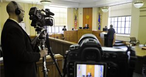 WCCO photojournalist David Chaney, left, records the proceedings of a civil case in Stearns County District Court in St. Cloud on March 9, 2012. It was the first time cameras had been allowed in a Stearns County courtroom for a civil case. This month the Minnesota Supreme Court revised rules on photo and audio coverage of criminal trials. (AP file photo: St. Cloud Times)