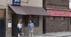 In this July 2017 photo, two unidentified men stand outside Born's Bar in St. Paul, not far from the spot where three men were stopped by police five years earlier after a report of a man carrying a gun. Robin K. Neal later sued a police officer and the city of St. Paul, charging excessive use of force. (Staff photo: Kevin Featherly)