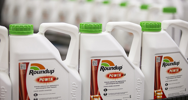Bottles of Roundup weed killer move along the production line at the herbicide manufacturing facility operated by Monsanto Co. in Antwerp, Belgium, in June 2016. (Bloomberg photo)