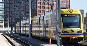 A Green Line train cuts through downtown Minneapolis in this file photo. The Metropolitan Council is seeking a consultant to assist with potential claims stemming from the Southwest and Bottineau Light Rail Transit lines. (File photo: Bill Klotz)