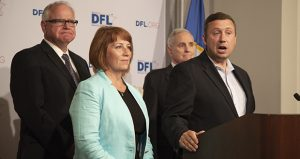Ken Martin, the DFL's state party chair, answers reporters' questions at a Thursday press conference that also featured Tim Walz (left), the party's gubernatorial candidate, and Erin Murphy, who finished second to Walz in Tuesday's primary. Gov. Mark Dayton looks on from the rear. Attorney General Lori Swanson—who finished third—was not invited, according to Martin. (Staff photo: Kevin Featherly)