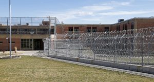 This 2017 file photo shows the Pexton Building, surrounded by barbed wire fencing, at the Minnesota Sex Offender Program in St. Peter. (AP file photo: Jim Mone)
