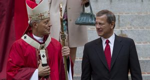 Cardinal Donald Wuerl, archbishop of Washington, speaks with U.S. Supreme Court Chief Justice John Roberts on the steps of the Cathedral of St. Matthew the Apostle after the 60th annual Red Mass in Washington on Sunday Sept. 30, 2012. Roberts was educated in Catholic institutions. (AP file photo)