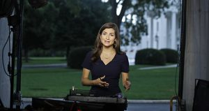 """CNN White House correspondent Kaitlan Collins talks during a live shot in front of the White House on Wednesday, July 25, in Washington. Collins says the White House denied her access to President Donald Trump's Rose Garden statement with the European Union Commission president because officials found her earlier questions """"inappropriate."""" (AP photo)"""