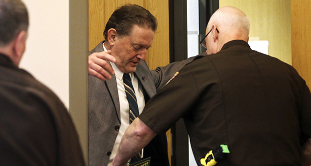 Authorities wand Byron Smith, left, as he re-enters Morrison County Courthouse on Tuesday, April 29, 2014, in Little Falls, Minnesota. Smith shot and killed two teenagers during a 2012 Thanksgiving Day break-in, and he was convicted of premeditated murder. (AP file photo: Star Tribune)
