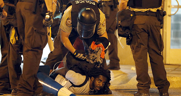 Police arrest a man Sept. 17, 2017, as demonstrators march in response to a not-guilty verdict in the trial of former St. Louis police officer Jason Stockley in St. Louis. Stockley was acquitted in the 2011 killing of a black man following a high-speed chase. (AP file photo)