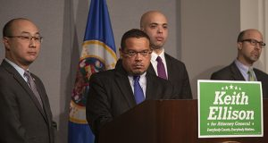 Flanked by supporters, DFL attorney general candidate Keith Ellison (center) fields a question from a reporter Monday. Also pictured are Ramsey County Attorney John Choi (left), former St. Paul City Attorney Sam Clark (behind Ellison) and Rep. Dave Pinto, DFL-St. Paul, a Ramsey County prosecutor. (Staff photo: Kevin Featherly)