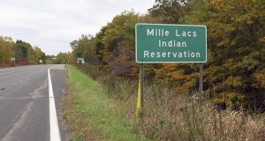 The Mille Lacs Band of Ojibwe will receive a total of $1,187,669 in public safety grants from the U.S. Justice Department. This undated photo shows a sign for the band's main reservation area about 100 miles north of the Twin Cities. (AP photo: Minnesota Public Radio)