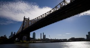 Amazon has announced it will split its second headquarters between Long Island City in New York and Arlington, Virginia. In this photo, the East River flows under the Ed Koch Queensboro Bridge and past the Long Island City skyline and waterfront. (AP photo)
