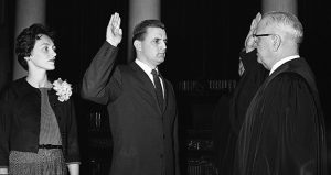 Onetime Minnesota Attorney General Walter Mondale recently confirmed that party affiliation was not a factor in selecting department staff. In this photo, Mondale, center, takes the oath of office as attorney general on May 5, 1960. Supreme Court Chief Justice Roger Dell, right, administers the oath while Mondale's wife, Joan, watches at left. (AP file photo)