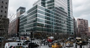 Vehicles pass in front of Goldman Sachs Group headquarters in New York. (Bloomberg file photo)