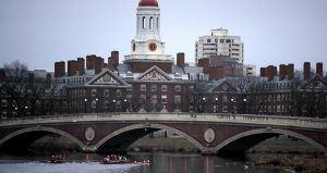 In this March 2017 photo, rowers travel down the Charles River past the campus of Harvard University in Cambridge, Massachusetts. (AP file photo)