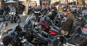 Rob Gregory, of Knoxville, Tennessee, sits on his motorcycle parked along Main Street Aug. 4 in Sturgis, South Dakota, during the 78th annual Sturgis Motorcycle Rally. (AP file photo: Rapid City Journal)