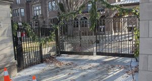 Aside from four traffic cones outside the Governor's Residence in St. Paul on Monday, there were few obvious signs of damage from a dramatic incident Sunday in which a man rammed his SUV through this locked gate. (Staff photo: Kevin Featherly)