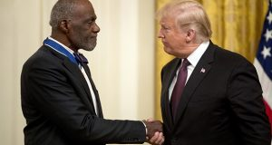 Former Minnesota Supreme Court Justice Alan Page shakes hands with President Donald Trump Friday after receiving the Medal of Freedom during a ceremony at the White House in Washington. (AP Photo/Andrew Harnik)