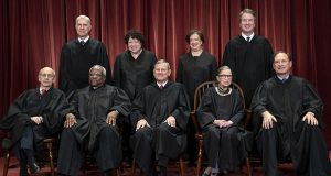 The justices of the U.S. Supreme Court gather for a formal group portrait. Seated from left: Justice Stephen Breyer, Justice Clarence Thomas, Chief Justice John G. Roberts, Justice Ruth Bader Ginsburg and Justice Samuel Alito Jr. Standing from left: Justice Neil Gorsuch, Justice Sonia Sotomayor, Justice Elena Kagan and Justice Brett M. Kavanaugh. (AP photo)