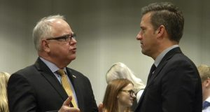 Gov. Tim Walz, left, talks with House Minority Leader Kurt Daudt just before a briefing for reporters on Monday in St. Paul. (AP photo: Steve Karnowski)