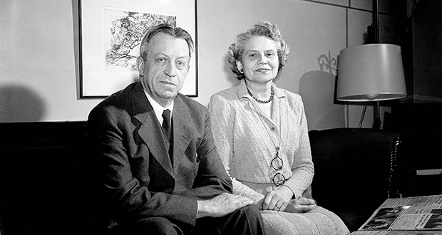 Judge J. Waties Waring and his wife, Elizabeth, look at scrap books of articles praising and condemning the judge's rulings in 1951 at their home in Charleston, South Carolina. (AP file photo)