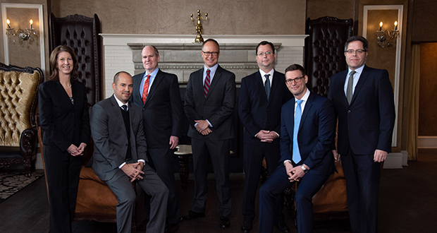 Pictured from left to right are Diane Peterson, Aaron Myers, Niall MacLeod, Michael Okerlund, Nick Boebel, Joseph Herriges and John Dragseth.