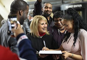 Judge Gina M. Brandt, center, watches as Mariah Mbonsal, right, signs wedding documents after her ceremony with Hamadicko Mbonsal on Feb. 14 at the Hennepin County Government Center in downtown Minneapolis. (Photo: Craig Lassig)
