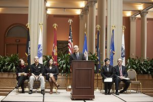 Ramsey County Attorney John Choi speaks during a fifth-anniversary celebration of the county's veterans treatment court. Also pictured (left to right): Mary Jo McGuire, a Ramsey County commissioner; Alexander Kempe, a veterans court graduate; Lyndsey Olson, the St. Paul city attorney; Nichole Starr, a Ramsey County district court judge; and John Guthmann, Ramsey County's district court chief judge. (Staff photo: Kevin Featherly)